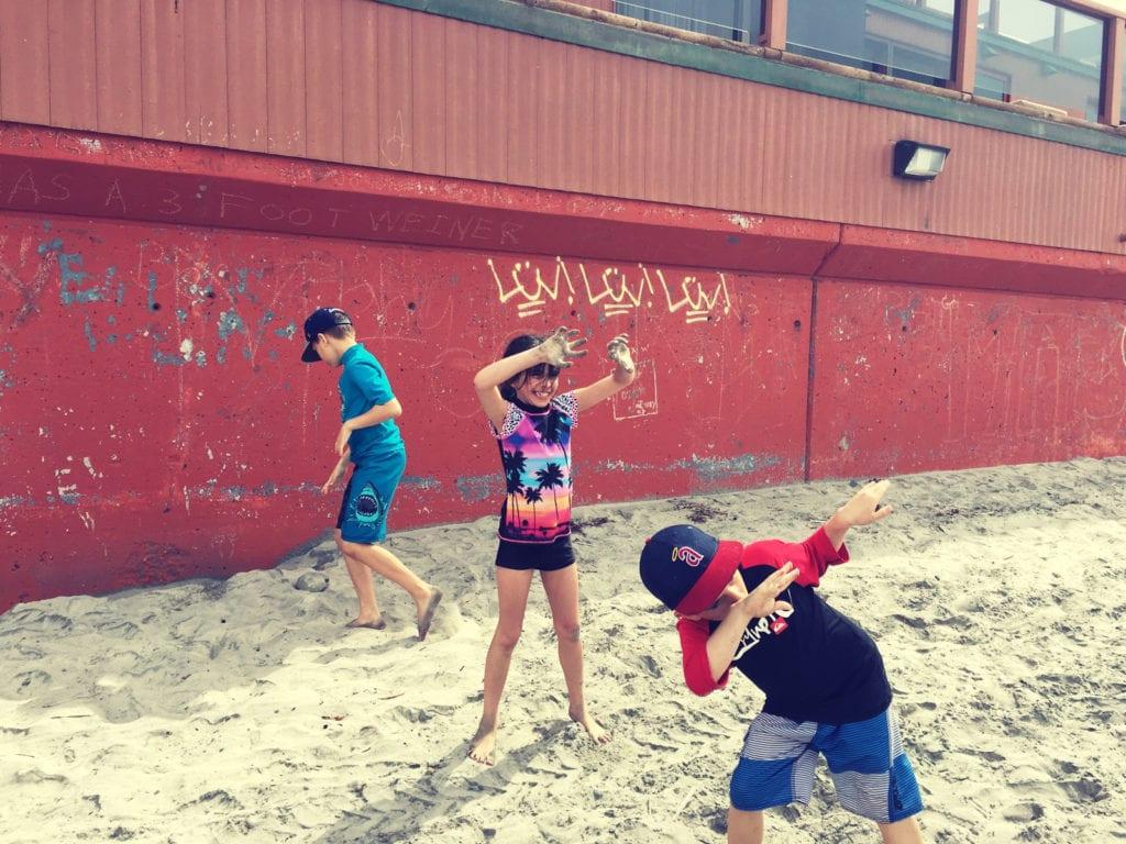 kids dabbing on the beach - family travel la jolla shores