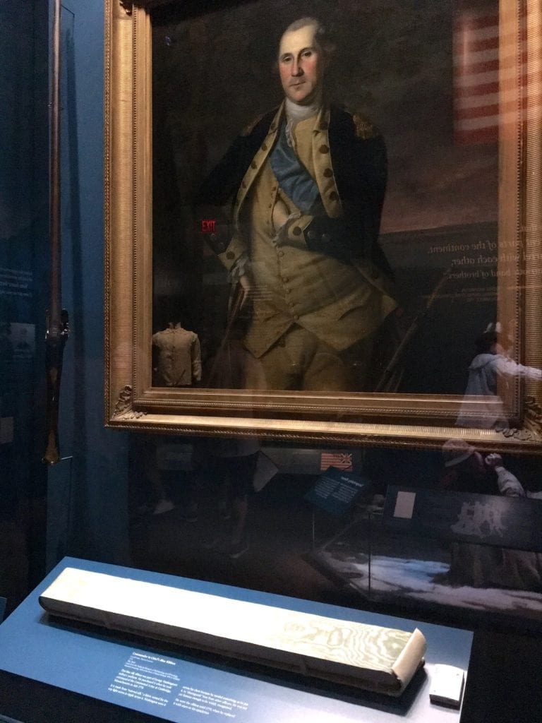 George Washington's blue silk sash is on display at the Museun of the American Revolution next to a 1776 portrait of Washington wearing the sash - Photo by Samantha Davis-Friedman