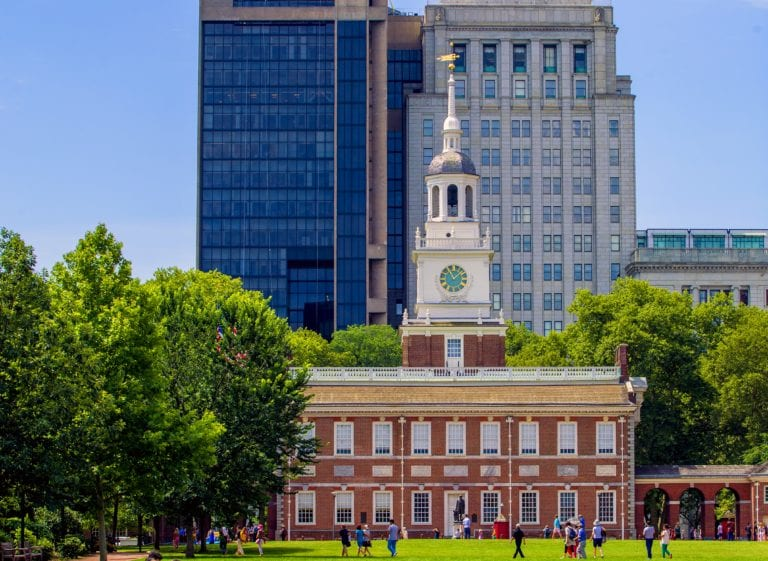 A centerpiece of Independence National Historical Park in Historic Philadelphia is Independence Hall. Built in 1753 to house the Colonial legislature, the building gained renown for being the site of the signing of the Declaration of Independence and the adoption of the U.S. Constitution. The lowest chamber of the original wooden steeple was the first home of the Liberty Bell, which now resides across the street. Visitors obtain free timed tickets for tours of Independence Hall at the Independence Visitor Center, located one block north at 6th and Market Streets.
