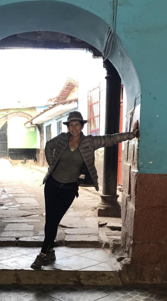 Standing in an archway in Cusco, Peru