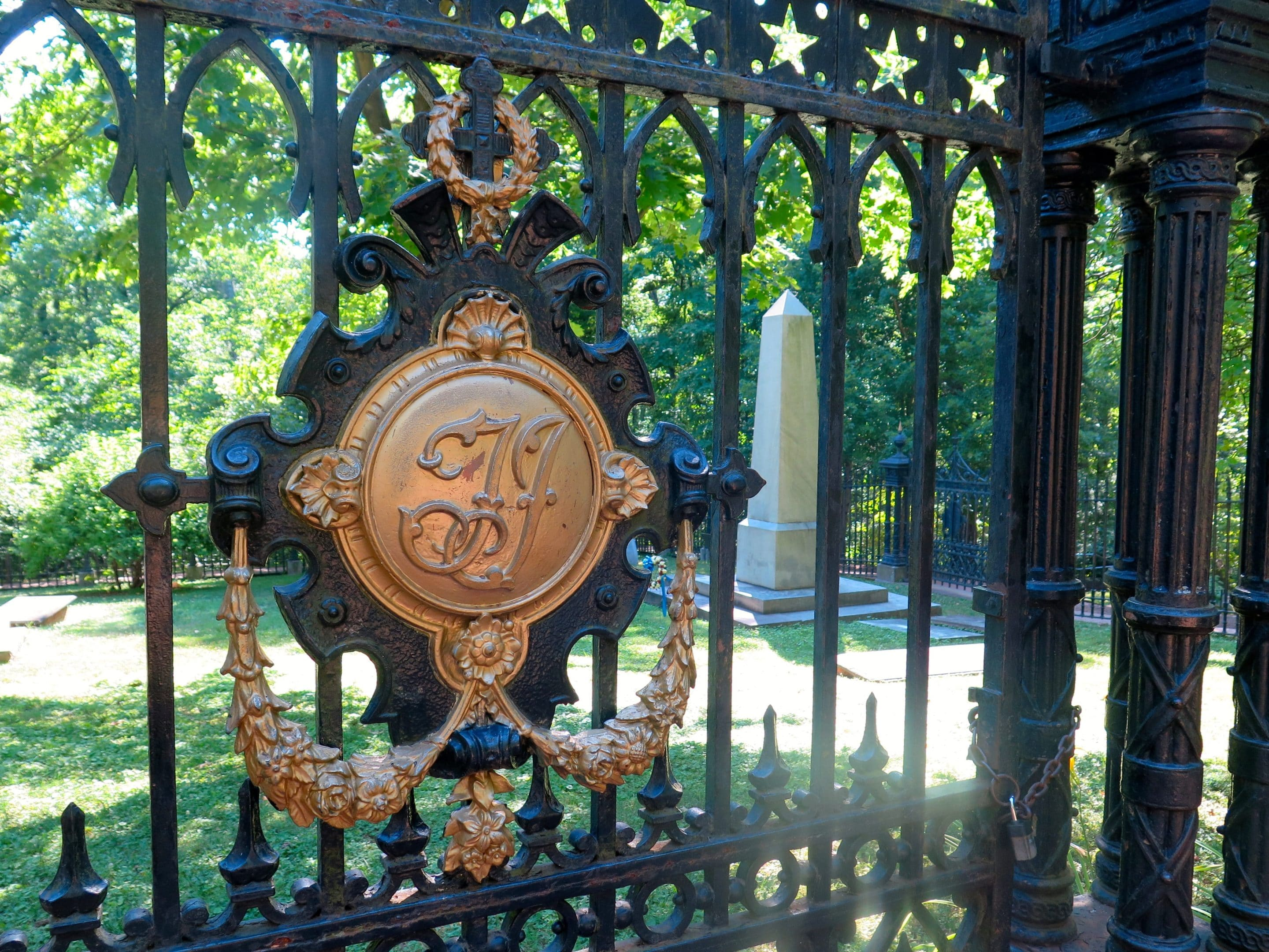 The gate to the graveyard at Monticello bears Thomas Jefferson's initials - Photo by Samantha Davis-Friedman