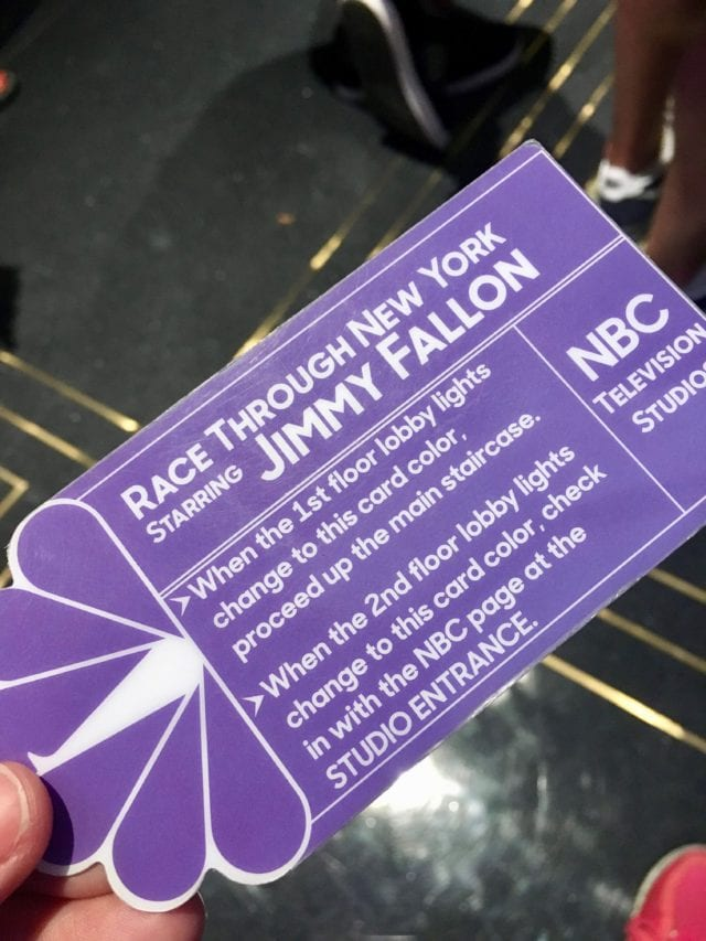 At the entrance to Race Through New York Starring Jimmy Fallon, riders are handed a colored ticket and are then free to explore on their own until it's their turn to ride - Photo Credit Samantha Davis-Friedman