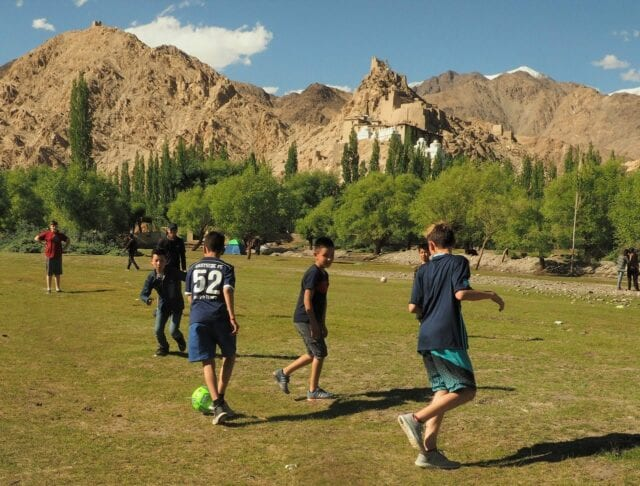 Playing soccer in Ladakh - volunteer family travel to India