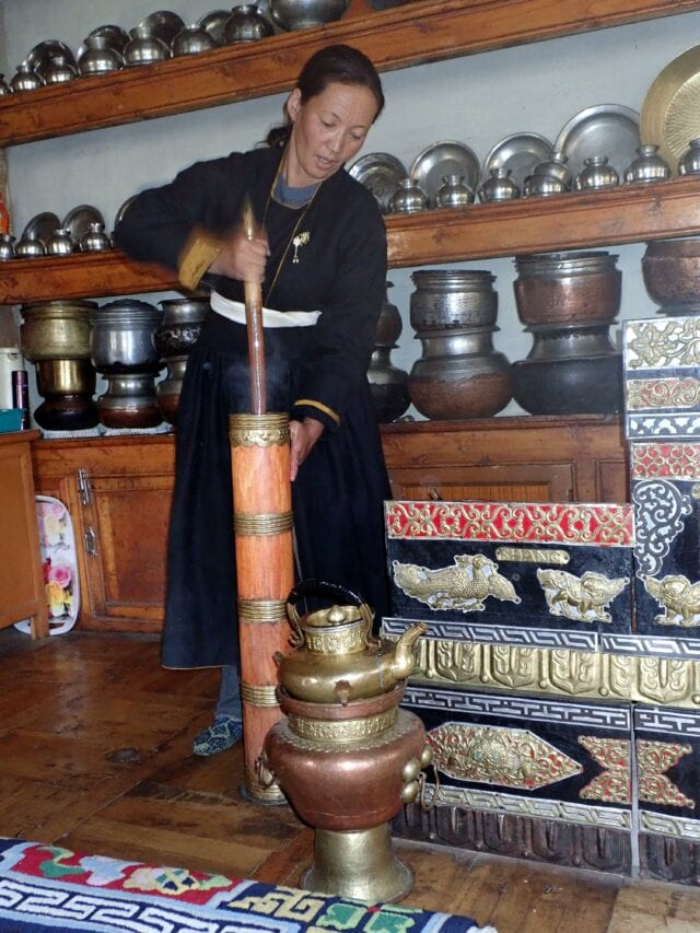 Making butter tea - volunteer family travel to India