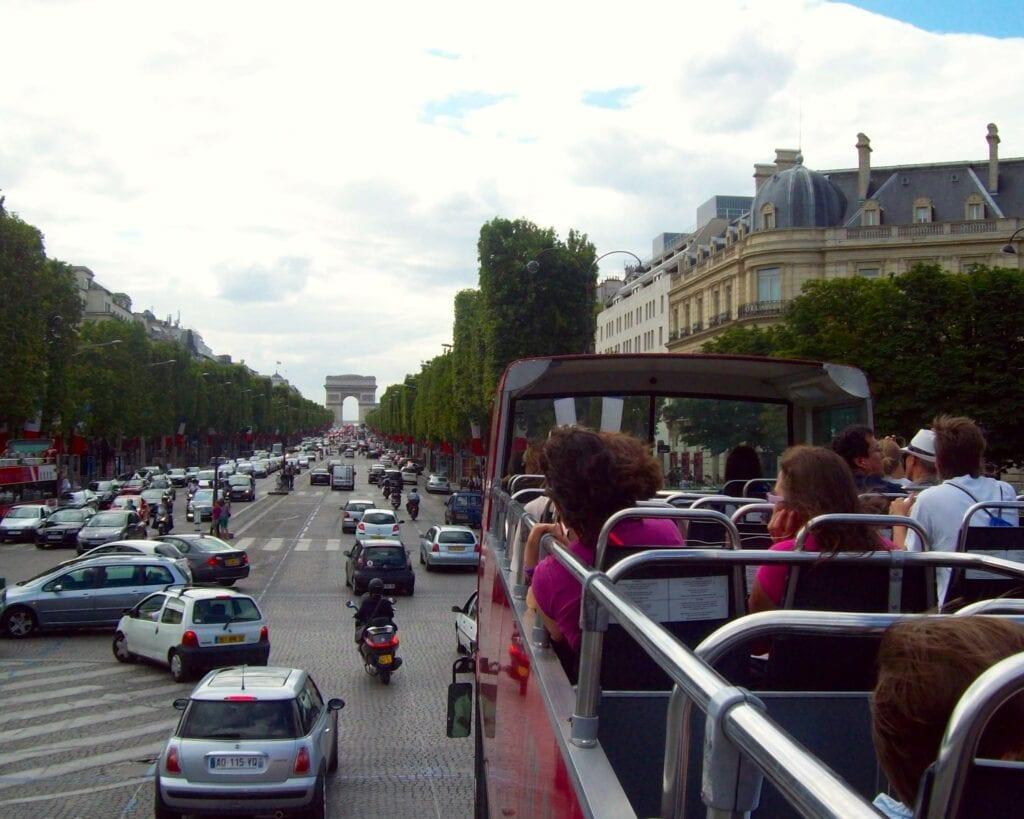 Hop-on, Hop-off bus on the Champs-Élysées in Paris - Photo by Samantha Davis-Friedman