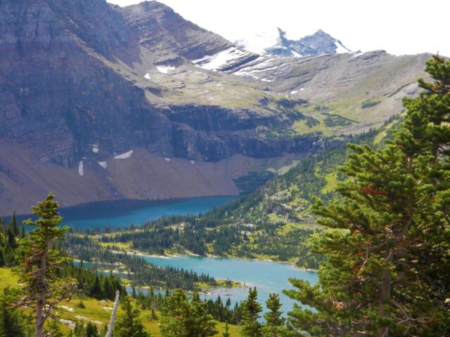 Snow in the mountains and pristine blue lakes in Glacier National Park in Montana