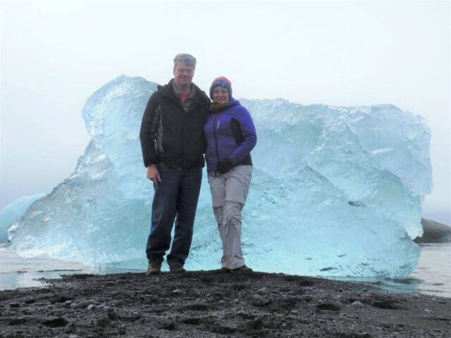 Standing in front of one of many large icebergs at Jokulsarlon Iceberg Lagoon in Iceland in 2018
