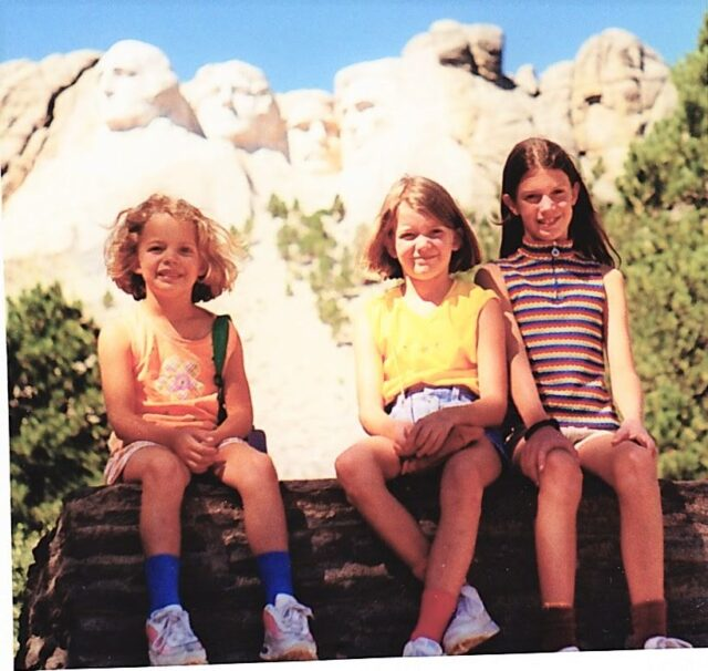 Girls in front of Mt. Rushmore in South Dakota on our first big road trip in 1999, 4 weeks from the east coast to the west and back.