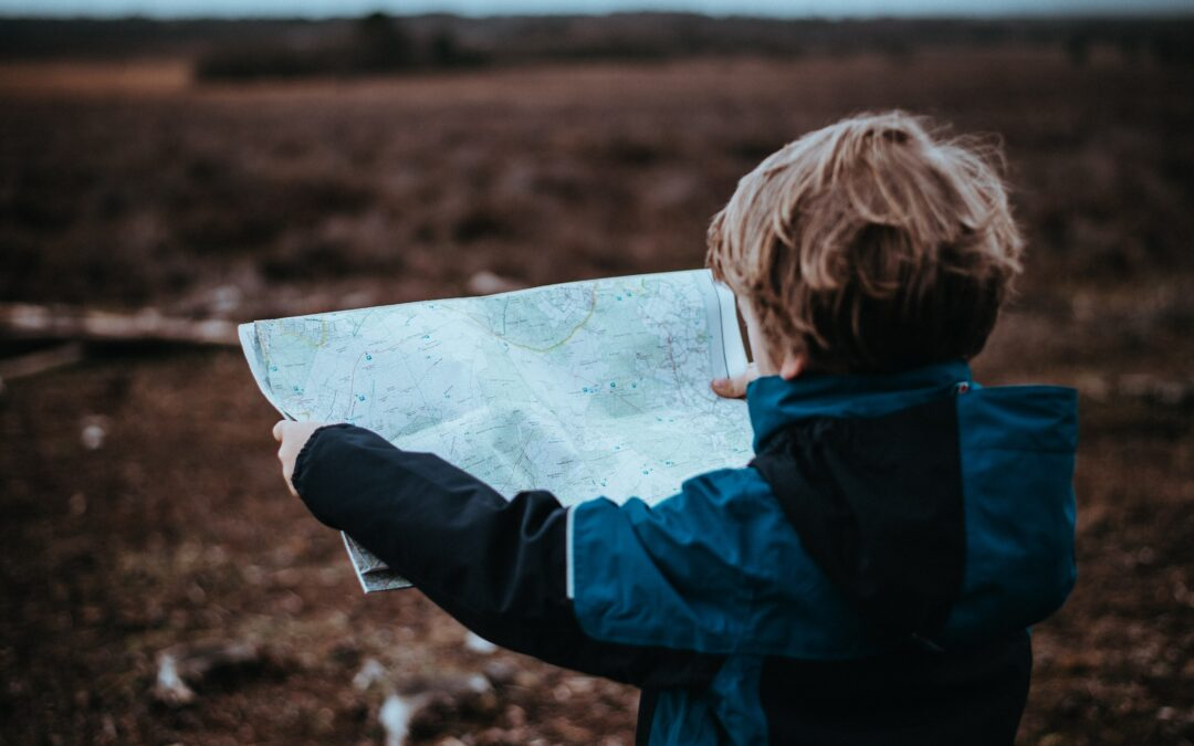 little boy looking at road map