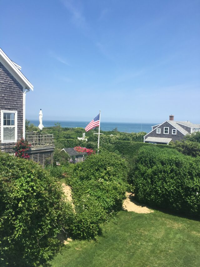 nantucket cedar shingle homes with american flag