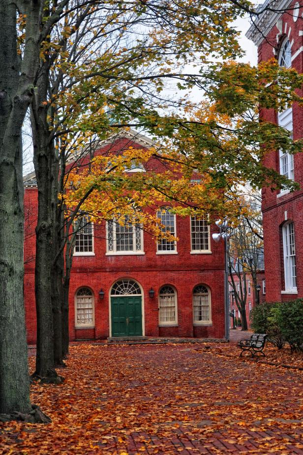 red house with fall foliage