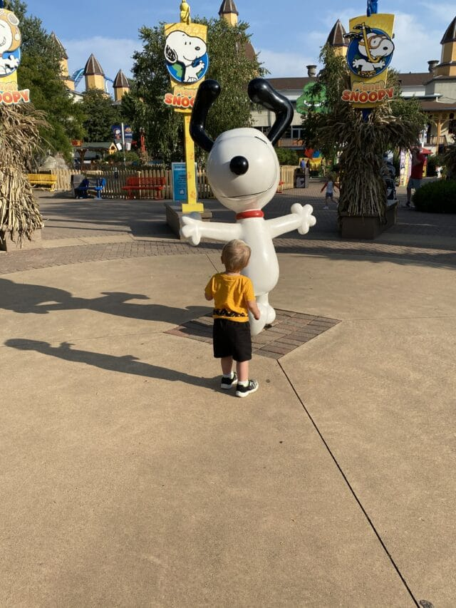 Photo of toddler with a snoopy statue