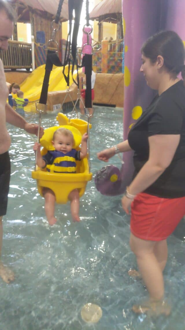 photo of toddler swing over a shallow pool.