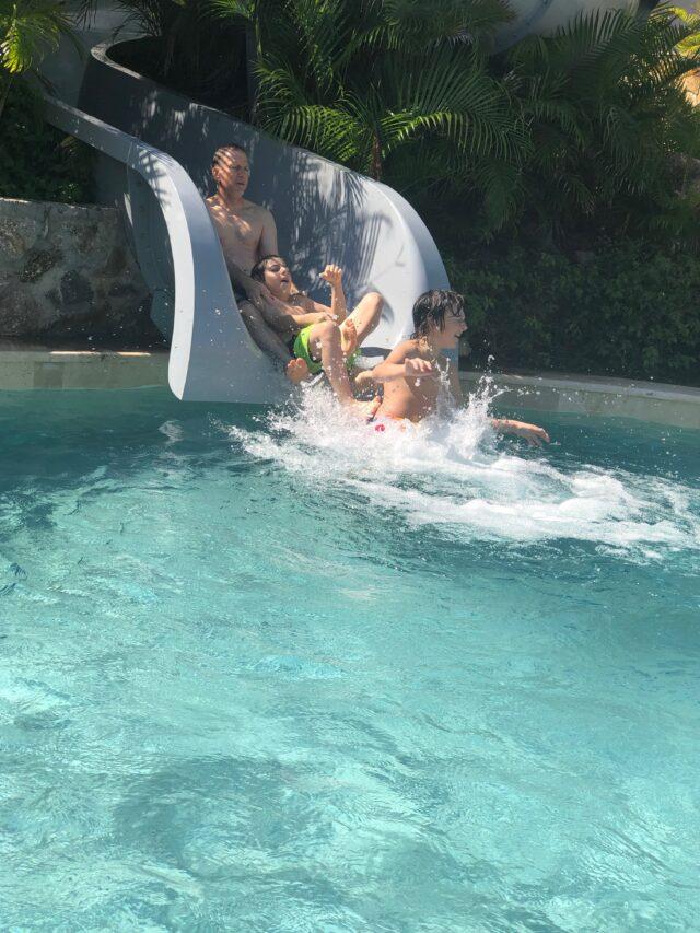 going down the waterslide at conrad punta de mita resort in mexico - riviera nayarit
