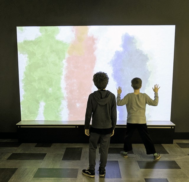 standing at a shadow screen - Best museums in Nashville for Kids