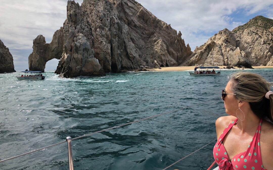 girl looking at el arco - things to do in Cabo San Lucas