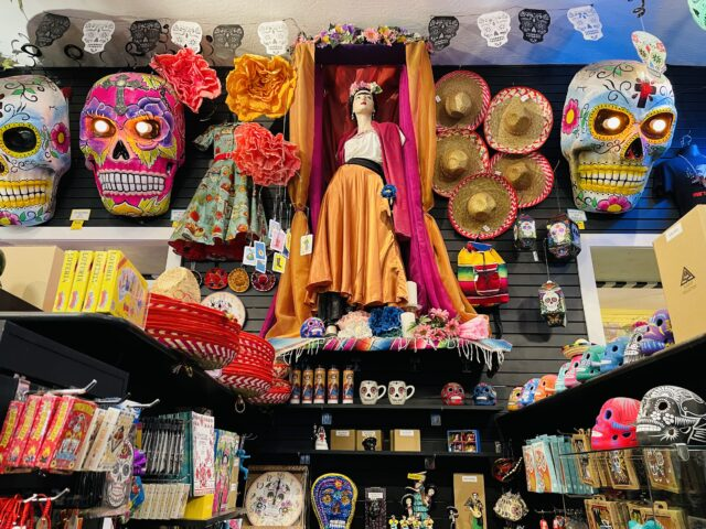 A statue of Frida Kahlo surrounded by painted skulls, sombreros, and other gift items. Things to do with kids in Sacramento.