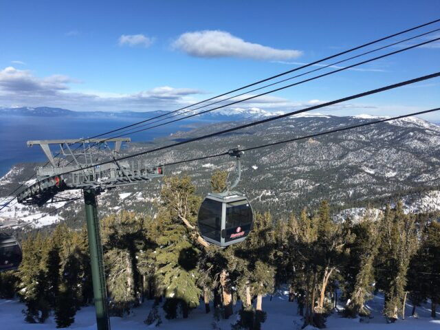 Image of the a gondola moving upwards, with pine trees and Lake Tahoe in the Background.7 Not To Miss Things To Do In South Lake Tahoe With Kids family travel