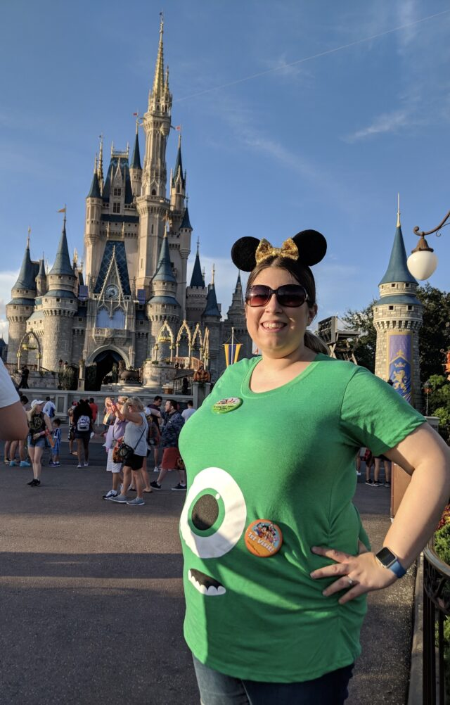magic castle in background - proud pregnant mama to be in front - Helpful hints and tricks to help you enjoy your babymoon and any other travels while you've got a bun in the oven!