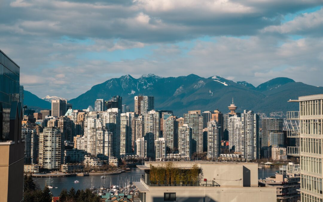 Vancouver skyline, with skyscrapers in the foreground and mountains behind. vancouver with kids how to spend the best long weekend family travel