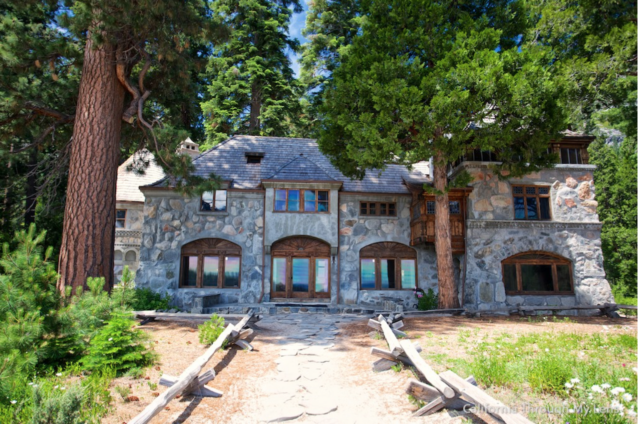 Front view of Vikingsholm, a stone mansion. Pine trees surround it.7 Not To Miss Things To Do In South Lake Tahoe With Kids family travel