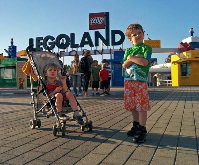 two boys in front of Legoland sign - Legoland was geared to my 5 & 3-year-olds. Here's why Legoland CA is perfect for toddlers & young kids