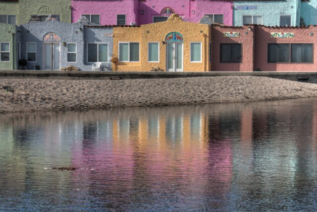 Pastel-colored buildings, with a pond in front. Best things to do with kids in Santa Cruz family travel