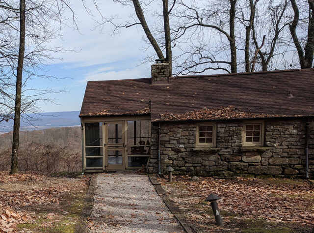 A stone cabin on a mountainside. Retreat to a cabin vacation weekendfor relaxing Labor Day fun.