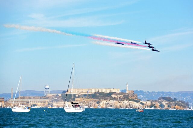Military jets flying in formation over San Francisco Bay, with sailboats in the foreground and Alcatraz in the back. Fall in the San Francisco Bay Area: Best Things to Do with Kids family travel halloween