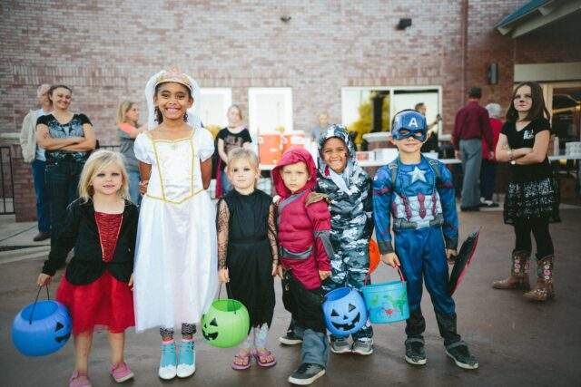 Children dressed on costumes smile at the camera. Fall in the San Francisco Bay Area: Best Things to Do with Kids family travel halloween